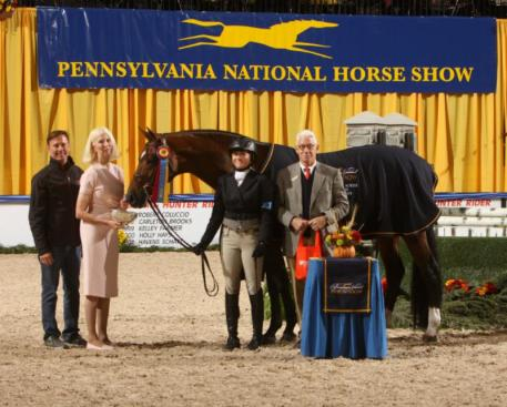 Victoria Colvin and OVATION receive their award from Norman White, Chairman of the Board of the Pennsylvania National Horse Show with trainer Scott Stewart and owner Dr. Betsee Parker