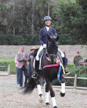 Anna Buffini and Sundayboy take their honors round winning the 2014 AGCO/USEF Young Rider Dressage National Championships Photo: Dr. George Kung