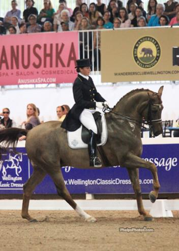Tinne Vilhelmson-Silfven of Sweden on Antonia Ax:son Johnson's 13 year old Rheinlander gelding Favourit, with a score of 73.255%. (Photo:Mary Phelps - phelpsphotos.com)