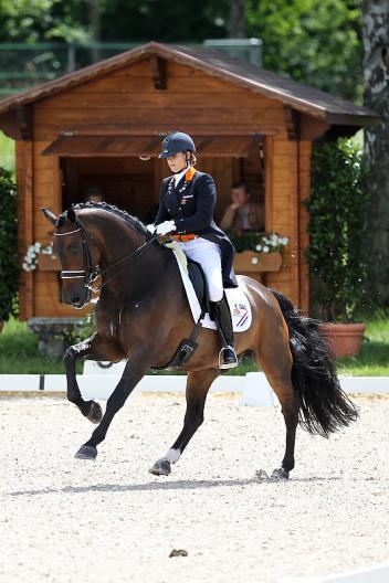 Dana van Lierop and DJ Tiesto secured a golden hat-trick for The Netherlands at the FEI European Dressage Championships for Young Riders and Juniors 2012 which drew to a close in Berne, Switzerland today.  Photo: FEI/Valeria Streun.