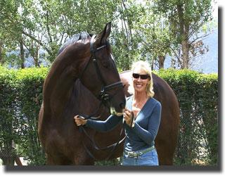 Charlotte with her Hanoverian gelding Westpoint, by Windfall