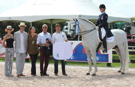 Lourdes Ariza and Naval Banamex accept the Choice of Champions Performance Award during the 12th week of the Adequan Global Dressage Festival
