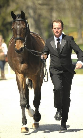 Will Faudree, looking incredibly handsome in black tie and tux, jogging Pawlow en route to winning the Dubarry Style Award and a pair of Dubarry boots. photo © Elisabeth Harpham - equidigital.com