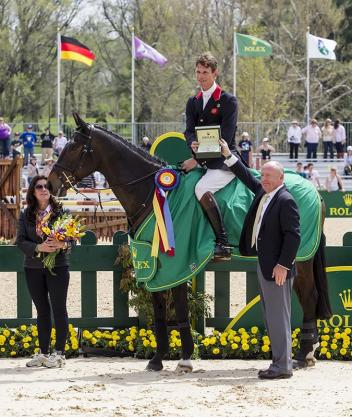 William Fox-Pitt accepted the Rolex watch for winning the Rolex Kentucky Three-Day Event on Bay My Hero from President and CEO Stewart Wicht. (Ben Radvani photo)