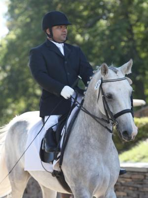 Although, born with his right lower leg attached to his hip, Freddie Win rode as a trick rider and member of the Burmese Equestrian Team. Now a practicing attorney living in New Jersey, Win is a rising USPEA hopeful.