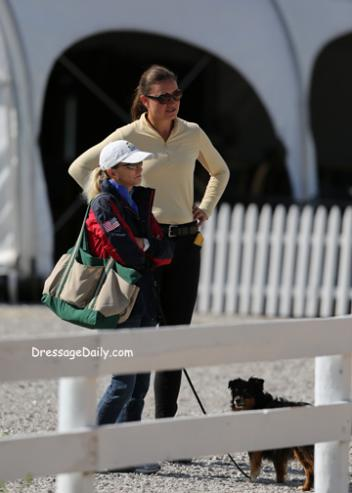 Olympian Debbie McDonald and Adrienne Lyle look on while working student Taylor Yamamoto take center stage at the Kentucky Horse Park. Photo: Mary Phelps