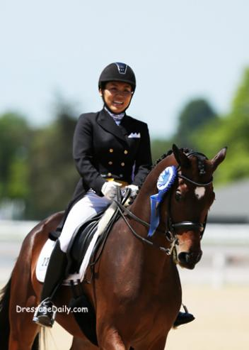 Taylor Yamamoto and Domino take a victory round after winning the FEI Young Rider Team Test. Photo: Mary Phelps