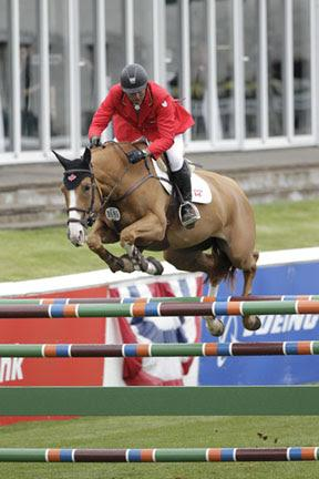 Yann Candele and Showgirl jumped clear for Canada in the second round of the 5,000 Furusiyya FEI Nations' Cup held Friday night, June 13, at the Spruce Meadows 'Continental' tournament in Calgary, AB. Photo Credit - Cansport