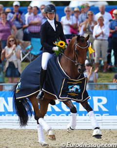 Laura Stigler and Doubleyou W won the 6-year old preliminary test at the 2013 World Young Horse Championships in Verden (Photo © Astrid Appels)