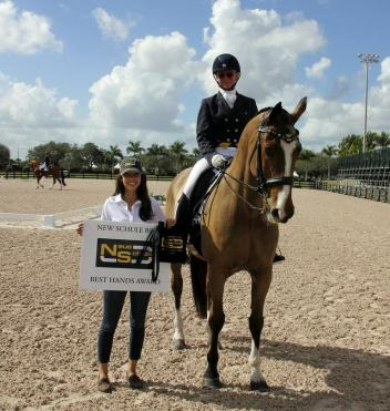 Chase Hickok presents Anna Whit Watkins with the Neue Schule Best Hands Award during the first week of the 2014 Adequan Global Dressage Festival.