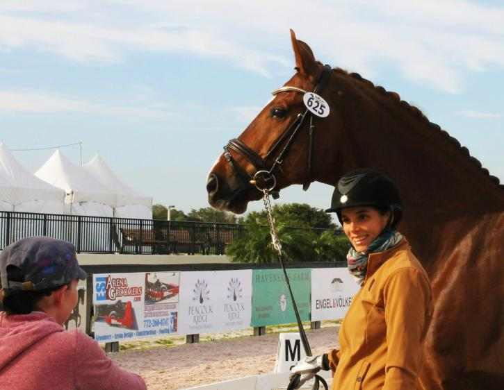 Naima Moreira-Laliberté talking with Janine Little, with Belafonte, before the FEI jog at the Adequan Global Dressage Festival.  (Photo credit: Joanna Cockerline)