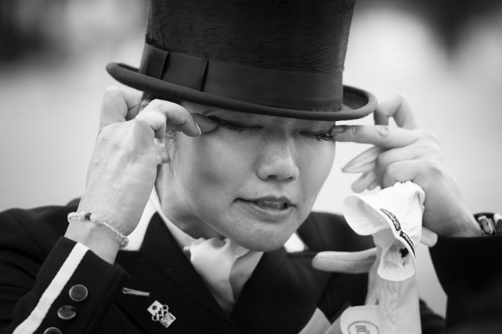 Japan's Akane Kuroki sheds tears of relief and delight after posting a good score with Toots (Photo: Richard Juillart/FEI)