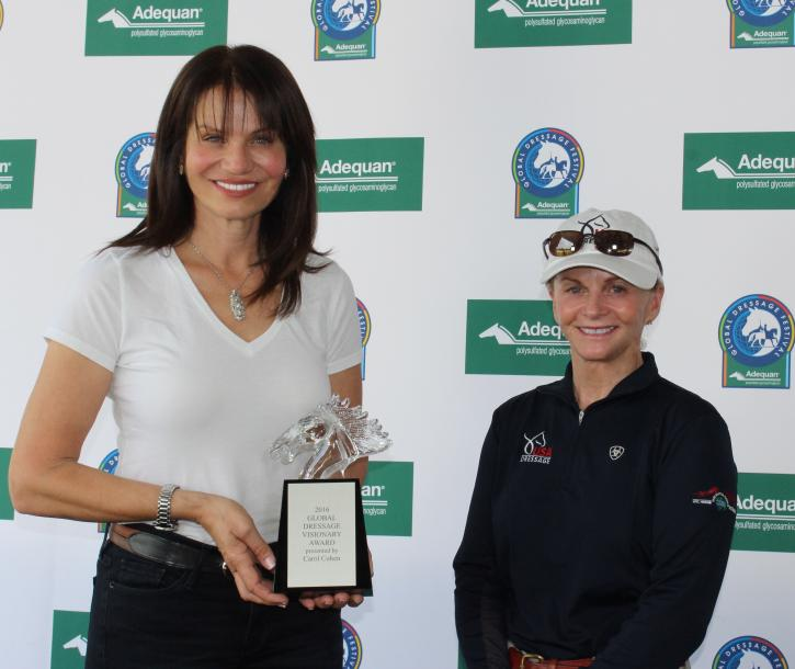 Carol Cohen presents the Global Dressage Visionary Award to U.S. Dressage Team Developing Coach and Olympian Debbie McDonald at the Adequan Global Dressage Festival.
