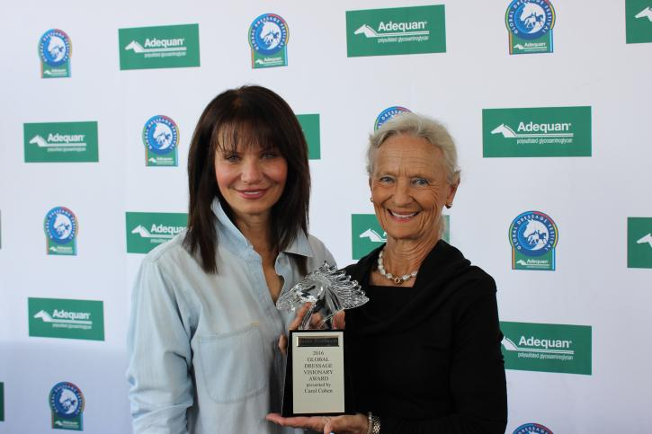 Carol Cohen presents Janne Rumbough with the Global Dressage Visionary Award during Week 8 of the Adequan Global Dressage Festival.