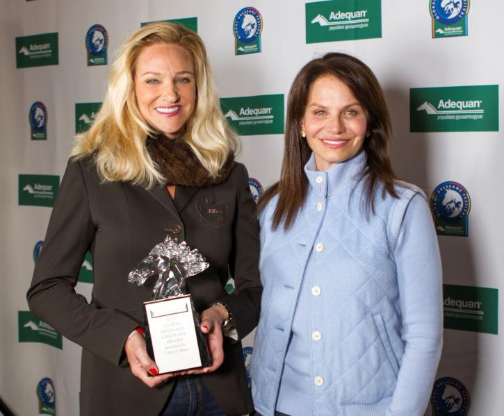 Carol Cohen presents Kimberly Van Kampen Boyer with the Global Dressage Visionary Award.