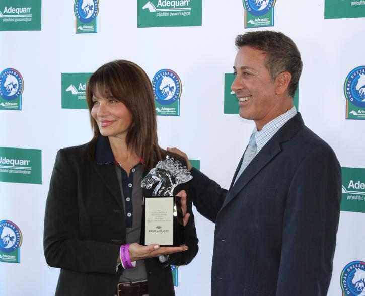 Carol Cohen presenting U.S. Dressage Chef d'Equipe, Robert Dover, with the very first Global Dressage Visionary Award at the Adequan Global Dressage Festival.