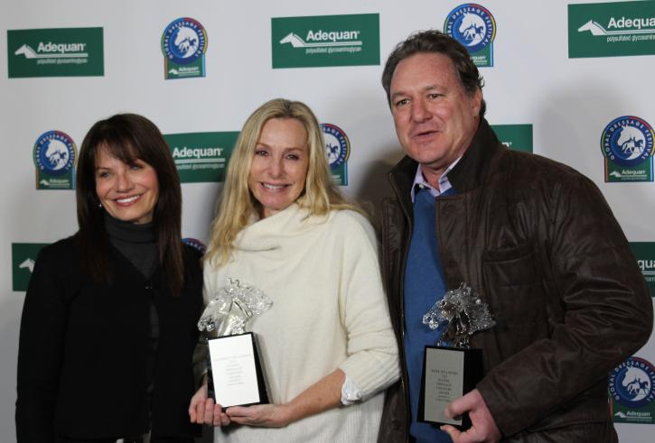 Carol Cohen presents Katherine and Mark Belissimo with the Global Dressage Visionary Award.