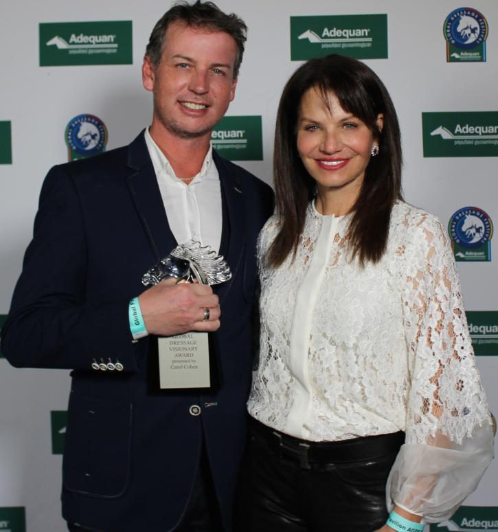 Carol Cohen (right) presents the Global Dressage Visionary Award to Olympian Carl Hester (left) at the Adequan Global Dressage Festival.