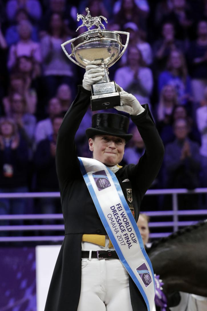 Isabell Werth from Germany displays her trophy after winning the Grand Prix Freestyle dressage Final in the FEI World Cup Finals in Omaha, Nebraska, USA on 01 April 2017.