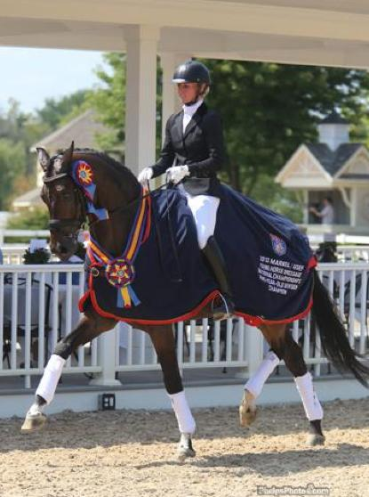 Fashion Designer OLD 2013 Five-Year-Old Champion,<br />Nadine Buberl riding for Piaffe Performance