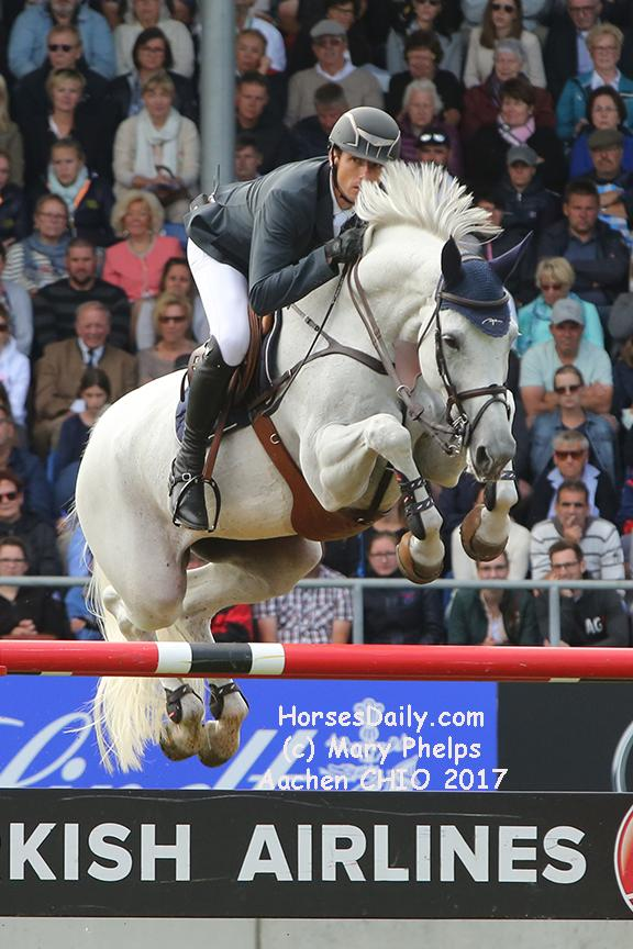 "Gregory Wathelet (Bel) and Coree winners of the 2017 Grand Prix of Aachen Westfalen Mare \ Grey \ 2006 \ Cornet Obolensky x Liberty Life. <br /><span style=""color: rgb(51, 51, 51); font-family: Neuton; font-size: 21px;"">Photo: (c) Mary Phelps</span>"