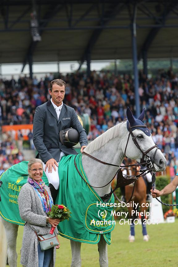 "<span style=""color: rgb(51, 51, 51); font-family: Neuton; font-size: 21px;"">Gregory Wathelet (Bel) and Coree winners of the 2017 Grand Prix of Aachen Westfalen Mare \ Grey \ 2006 \ Cornet Obolensky x Liberty Life<br />Photo: (c) Mary Phelps</span>"