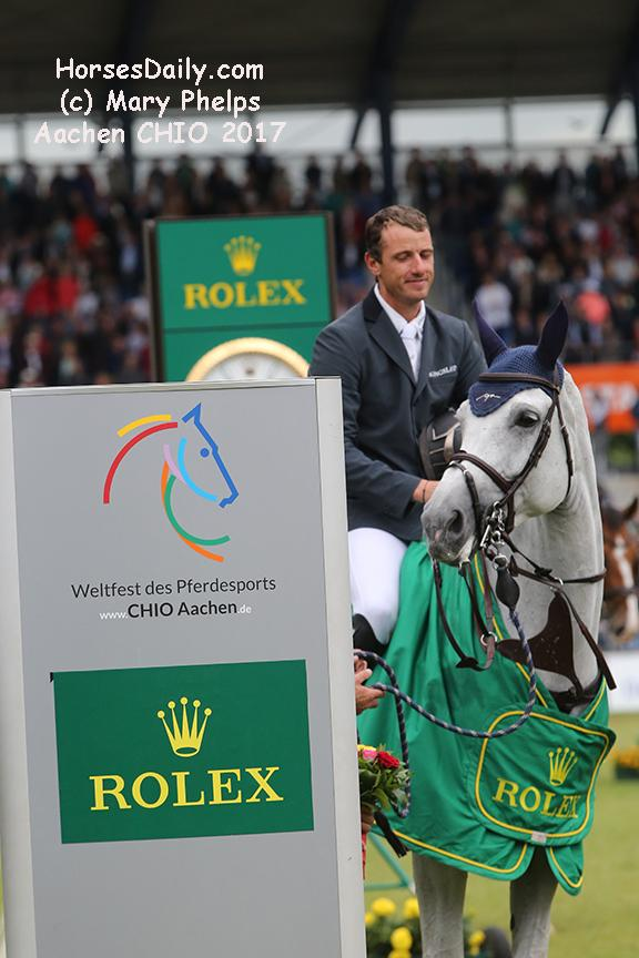 "<span style=""color: rgb(51, 51, 51); font-family: Neuton; font-size: 21px;"">Gregory Wathelet (Bel) and Coree winners of the 2017 Grand Prix of Aachen Westfalen Mare \ Grey \ 2006 \ Cornet Obolensky x Liberty Life<br />Photo: (c) Mary Phelps</span><br />"