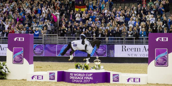 Isabell Werth (GER) and Weihegold celebrate their win with a victory gallop (Photo: Cara Grimshaw/FEI)