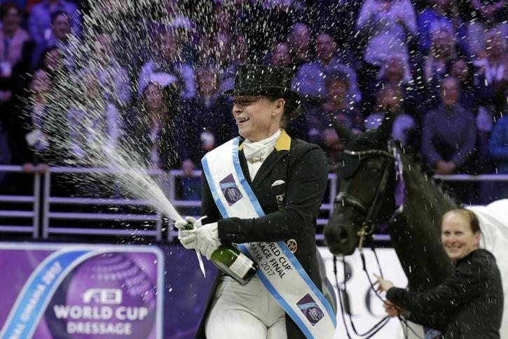 Isabell Werth celebrates her win watched by her groom Steffi Weigard and her beautiful mare Weihegold (Photo: Jim Hollander/FEI)