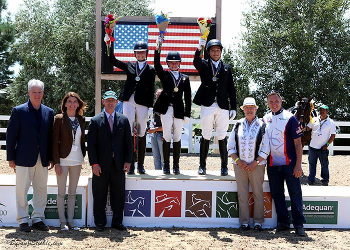 Jenna Upchurch, Vanessa Creech-Terauds, and Carlos Maldonado Lara in their medal presentation ceremony with Stephan Hienzsch, Executive Director of USDF; Meg Krueger, COO of The Colorado Horse Park; Bill Moroney, CEO of USEF; Jennie Loriston Clarke, Foreign Technical Delegate; and Allyn Mann of Adequan®. (Photo: Susan J. Stickle)