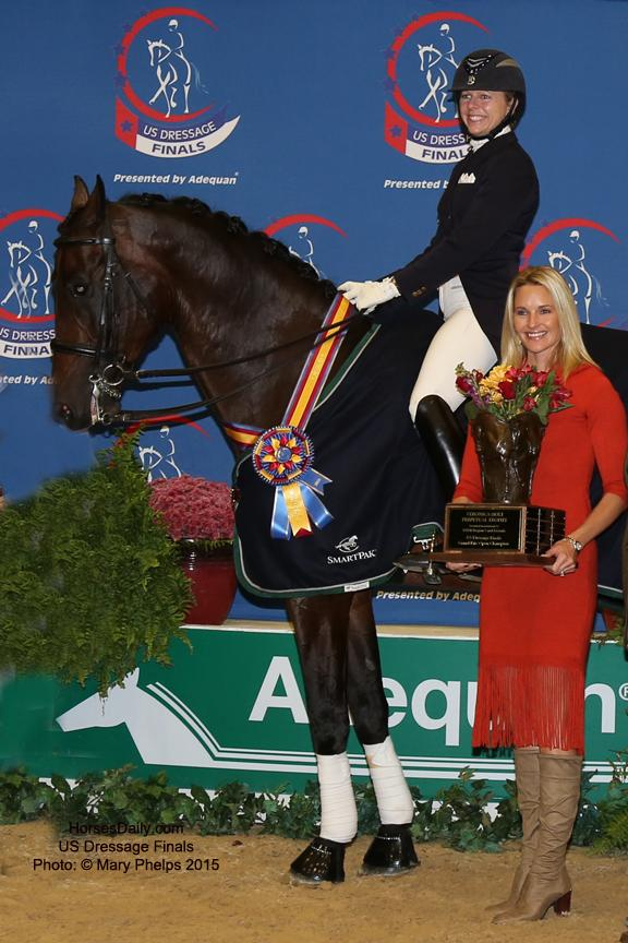 Sally Hayes presents the Veronica Holt Trophy in honor of her mother to Gwen Poulin and William Photo: © Mary Phelps 2015