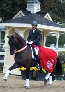 Cesar Parra (White House Station, NJ) and Michael Davis'<br />Simply Nymphenburg (Sir Donnerhall I-Wendy by Weltmeyer)<br />Six-Year-Old Reserve Championship 2012