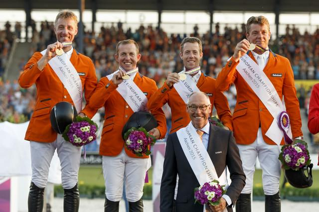 The Netherlands' (L to R) Jur Vrieling, Gerco Schroder, Maikel van der Vleuten and Jeroen Dubbeldam with Chef d'Equipe Rob Ehrens celebrate team gold at the FEI European Jumping Championships 2015 in Aachen, Germany.<br />(Photo: FEI/Dirk Caremans)