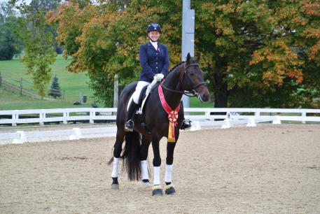 Kate Poulin and 7-year-old Count Sinclair (Lord Sinclair), owned by Sally Gries, won the Reserve Championship in the 2014 Region 2 2nd Level Open. (Photo: Poulin Dressage)