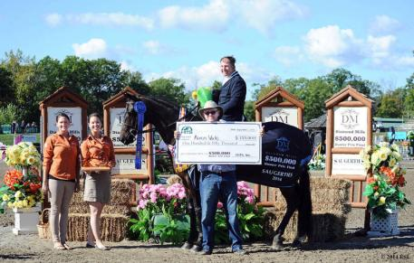 Lindsay Yandon and Asia Manning of HITS present top honors, including a Horseware Ireland cooler and 50,000 winner's check to Aaron Vale and Dress Balou. ©ESI Photography