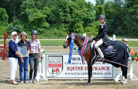 Sue Berube presented Abigail Tinsley and In the Game with top honors after the Eaton & Berube Children's Hunter Pony Finals presented by Mona's Monograms at HITS Saugerties. ©ESI Photography