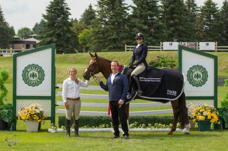 Ainsley Vince and Magic Show are presented as the winners of the 0,000 Canadian Hunter Derby, presented by Faces Magazine, by Justin MacKinnon of Faces Magazine and Karen Sparks of Wesley Clover Parks. (Photo: Ben Radvanyi Photography)