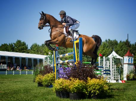 Alex Granato and Mullaghdrin Rado finished second in the Evergreen Invitational Grand Prix. Photo: Andrew Ryback/ChicagoEquestrian