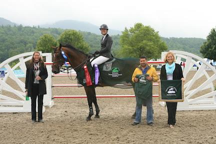 Following her win in the $30,000 Vermont Summer Special Grand Prix, presented by Johnson Horse Transportation, Amanda Flint (pictured on Child Z) and groom Marco Turcios, are honored by Jennifer Glass and Ruth Lacey of the Vermont Summer Festival. (Photo: David Mullinix Photography)