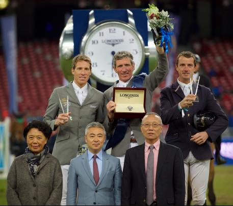 The prize-giving ceremony of the Longines Grand Prix with Henrik von Eckermann, Ludger Beerbaum and Gregory Wathelet on the podium and Jing Li, CEO of Dashing Equestrian, Dennis Li, vice-president of Longines China, and Li Nianxi, chief secretary of the Chinese Equestrian Association, in the front.