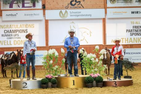 The individual podium at the 2016 SVAG FEI European Reining Championships for Seniors – Gennaro Lendi (ITA) in gold, Grischa Ludwig (GER) in silver and Tina Kuenstner-Mantl (AUT) in bronze (FEI/ Andreas Kost)