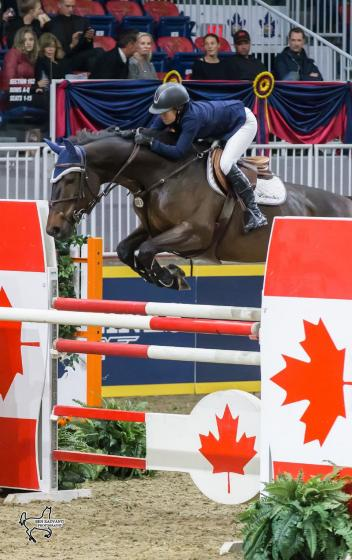 Ali Ramsay of Victoria, BC, placed second in the opening round of the 25,000 Canadian Show Jumping Championship riding Hermelien VD Hooghoeve on Friday, November 3, at the Royal Horse Show.
