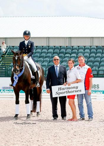 Allison Brock and Rosevelt in their presentation ceremony with judge Peter Storr (GBR), Cora Causemann of AGDF, and Allyn Mann of Adequan®.