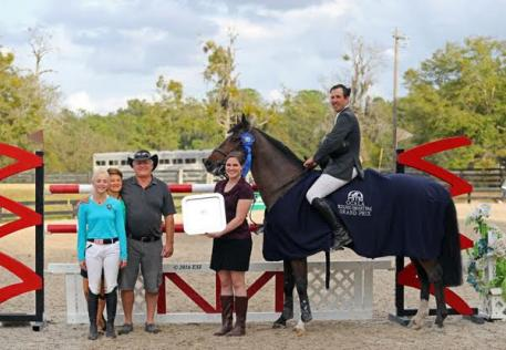 Andrew Kocher and USA Today winning the $25,000 HITS Grand Prix.
