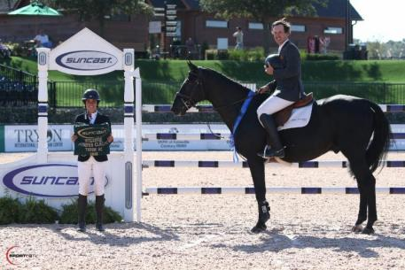 Andy Kocher and Zantos II in their presentation ceremony with Lauren Tisbo of Suncast®.