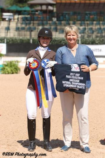 Angela Peavy is honored with the 2017 USEF Para Equestrian Dressage National Championships presented by Deloitte with judge Kristi Wysoki (USA).