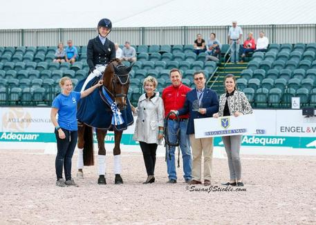Arlene Page and Woodstock in their presentation ceremony with judge Janet Foy, Allyn Mann of Adequan®, Javiar Bacariza of Yeguada De Ymas, and Sponsorship Coordinator Cora Causemann.