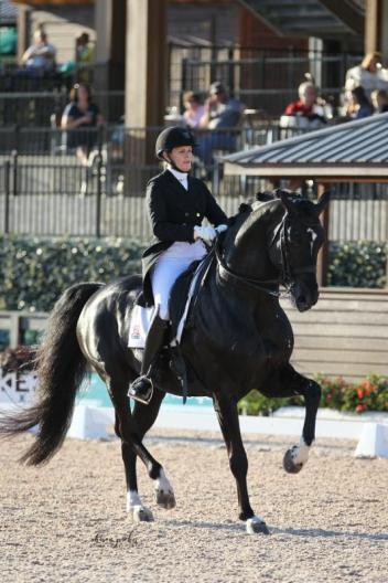 Ashley Holzer and Dressed In Black on their way to winning the FEI Grand Prix Freestyle CDI 3* presented by Adequan® at the first inaugural FEI CDI 3*  hosted at TIEC.