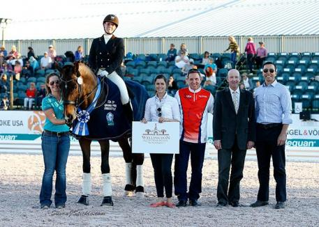 Beatrice Marienau and Stefano 8 in their presentation ceremony with Cora Causemann of AGDF, Allyn Mann of Adequan®, judge Eddy de Wolff van Westrrod, and Rob Desino of Wellington Equestrian Realty.