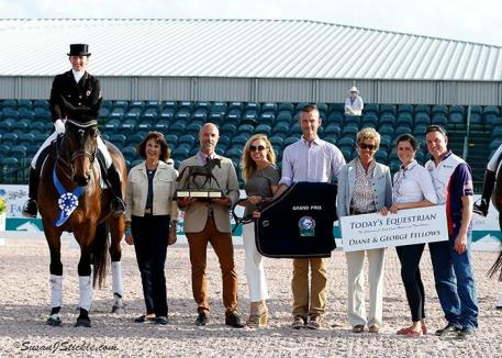 Belinda Trussell and Anton in their presentation ceremony with Mary Anne McPhail, Patrick Roggenbau, Diane Fellows, Walter Bagley of AGDF, judge Ulrike Nivelle, Cora Causemann of AGDF, and Allyn Mann of Adequan®.